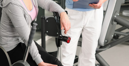 Woman working with a physical therapist.